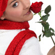 Woman holding single red rose — Stock Photo #11886994