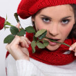 Brunette with rose in her mouth — Stock Photo