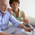 Senior couple shopping on-line — Stock Photo #11887388