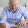 Senior man shopping on-line — Stock Photo #11887408
