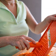 Woman grating a carrot - Stockfoto
