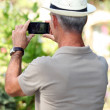 Senior man taking pictures — Stock Photo #11887540