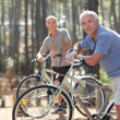 Stock Photo: Friends cycling
