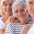 Closeup of two older couples out in the sunshine — Stock Photo