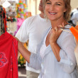 Senior woman on vacation shopping — Stock Photo #11887744