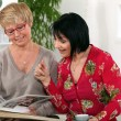 Stock Photo: Two senior women spending time together