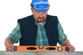 Bricklayer taking measurements — Stock Photo