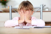 Frustrated child unable to complete her homework — Stock Photo