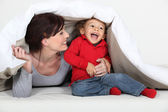 Woman playing a hiding game with her child — Stock Photo
