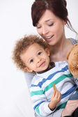 Mother and her son eating a cookie. — Stock Photo