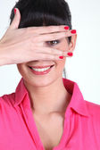 Woman covering her face with her hand — Stock Photo