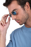 Man with blue sunglasses — Stock Photo