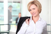 Businesswoman carrying her jacket over her shoulder — Stock Photo
