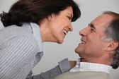 Mature couple laughing together — Stock Photo