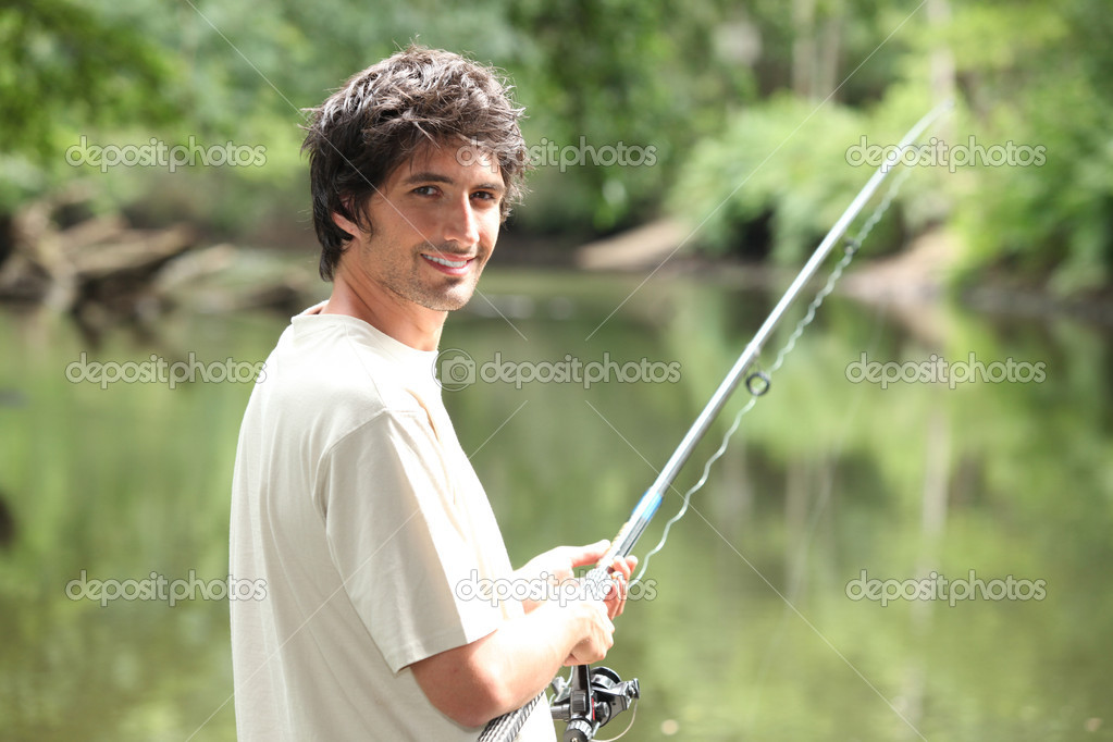 Man fishing on a river  Stock Photo #11880771