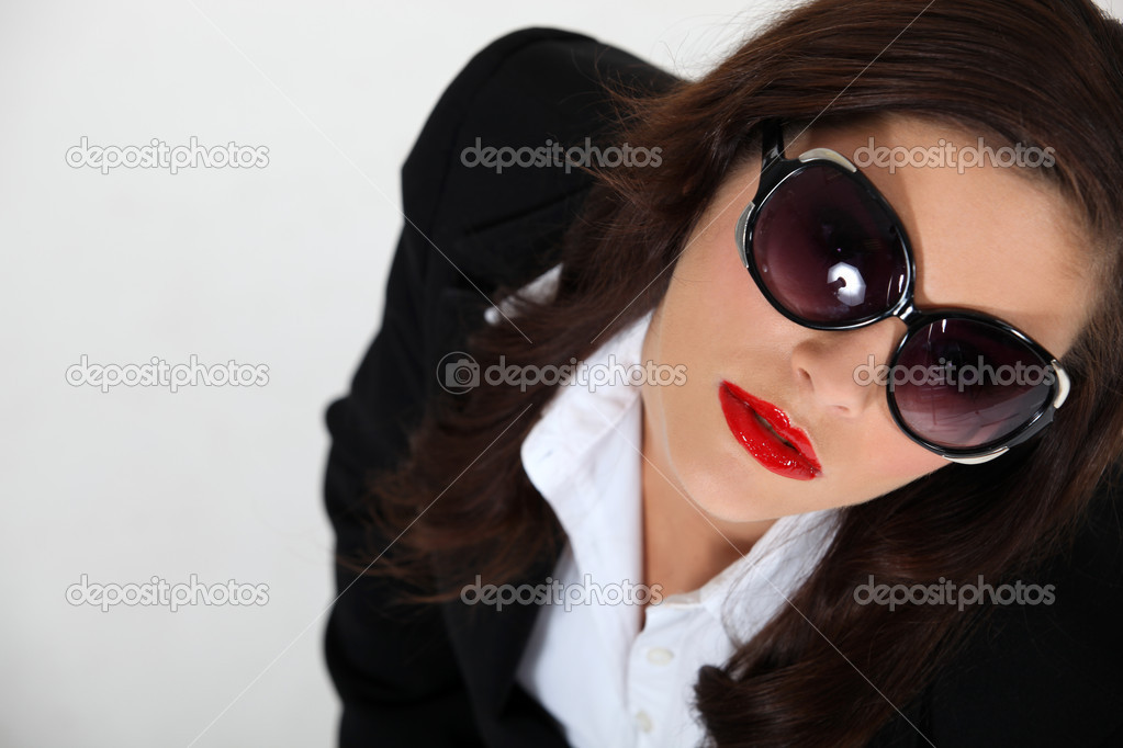Sexy woman wearing sunglasses — Stock Photo #11887025