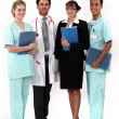 Foto Stock: Hospital workers posing together