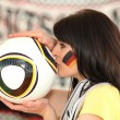 Stock Photo: German fan kissing a football