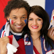 Couple of French soccer fans - Stock Photo