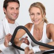 Couple in gym — Stock Photo #11893548