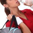 Stock Photo: Athlete drinking water