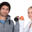 Young couple with dumbbells — Stock Photo