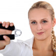 Blonde woman using hand grip — Stock Photo #11893898