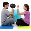 Stock Photo: A couple lifting weights.