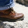 Man's boot on stone — Stock Photo
