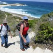 Couple hiking by coast — Stock Photo #11894406