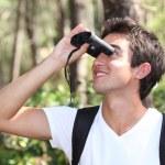 Girl with binoculars — Stock Photo #11894641