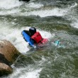 Canoing down rapids - Stock Photo