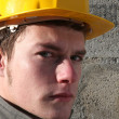 Serious looking laborer - Stock Photo