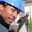 Stock Photo: Men working on a house