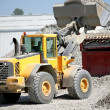 Construction vehicles transporting gravel — Stockfoto
