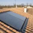 Stock Photo: Solar panel on a house roof