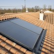 Stock Photo: Solar panel on house roof