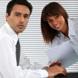 Business couple working together — Stock Photo