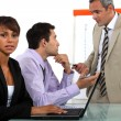 Three businesspeople in a team meeting — Stock Photo