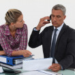 Stock Photo: Businessmand assistant working together