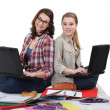 Two female students with laptops — 图库照片