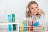 Blonde female biologist posing in lab — Stock Photo