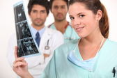 Nurse looking at ultrasound — Stock Photo