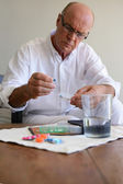 Senior man with medication — Stock Photo