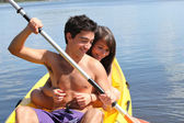 Young couple kayaking — Stock Photo