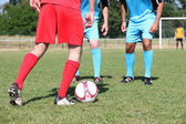 Close up of footballers' legs during friendly game — Stockfoto