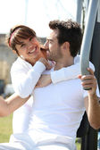 Couple using outdoor gym equipment — Stock Photo