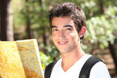Trekker reading a map — Stock Photo