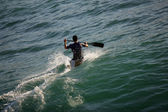 Man canoing in the sea — Stock Photo