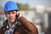 A construction foreman talking on his mobile phone — Stock Photo
